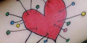 Corazón con Alfileres