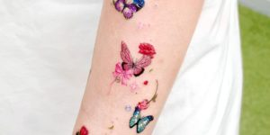 Mariposas de colores revoloteando por Studio by Sol, Song E. Tattoo