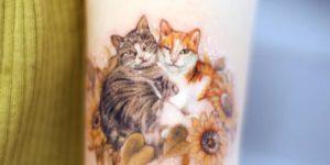 Gatitos acurrucados por Chaewha Tattoo