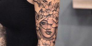 Rostro de Mujer sumergido en Flores y Mariposas por Jai Cheong
