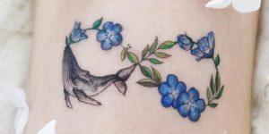 Signo infinito: ballena y flores por Tattooist Dal